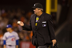 SAN FRANCISCO, CA - MAY 03: MLB umpire Joe West #22 holds a baseball during the sixth inning between the San Francisco Giants and the Los Angeles Dodgers at AT&T Park on May 3, 2013 in San Francisco, California. The San Francisco Giants defeated the Los Angeles Dodgers 2-1. (Photo by Jason O. Watson/Getty Images) *** Local Caption *** Joe West