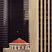5/7/2002 church nws.The First United Methodist Church sits wedged between two of  Seattle's tallest  downtown buildings.  The building, damaged in  the 2001 earthquake, will be torn down and replaced by condos.  Photo by Joshua Trujillo.