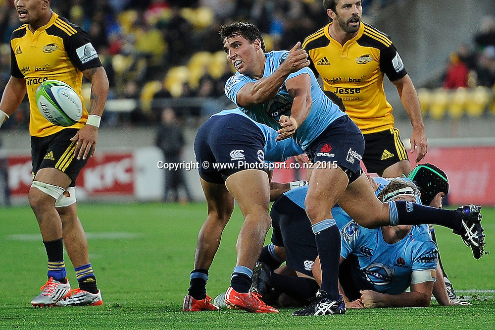 Waratahs' Bernard Foley passes out the scrum ball during the Super Rugby - Hurricanes v Waratahs rugby union match at the Westpac Stadium in Wellington on Saturday the 18th of April 2015. Photo by Marty Melville / www.Photosport.co.nz