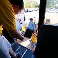 Thomas Wells | Buy at PHOTOS.DJOURNAL.COM<br /> Cody Voyles, 16, left, and Jackson Whitt, 16, begin loading students bags for the long trip to Australia on Wednesday.