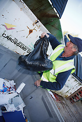 Man with a mild learning disability working as a factory cleaner, shown here throwing away rubbish, helped into employment by the Ready 4 Work team, Nottinghamshire County Council