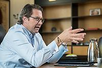 03 JUL 2019, BERLIN/GERMANY:<br /> Andreas Scheuer, CSU, Bundesminister fuer Verkehr und digitale Infrastruktur, waehrend einem Interview, in seinem Buero, Bundesministerium fuer Verkehr und digitale Infrastruktur<br /> IMAGE: 20190703-01-053