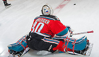 KELOWNA, CANADA - NOVEMBER 18: Michael Herringer #30 of the Kelowna Rockets stretches on the ice during warm up against the Vancouver Giants on November 18, 2016 at Prospera Place in Kelowna, British Columbia, Canada.  (Photo by Marissa Baecker/Shoot the Breeze)  *** Local Caption ***