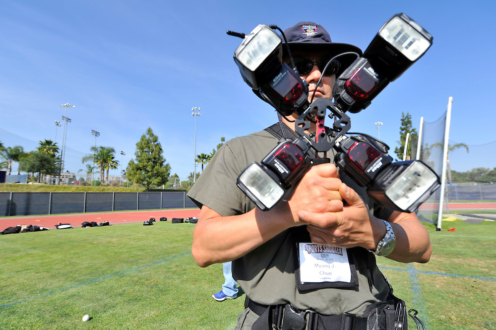 4/27/12  --- SPORTS SHOOTER ACADEMY --- SSA instructor Myung J. Chun holds a Lightware FourSquare before the start of a high-shutter speed strobe shoot during Sports Shooter Academy IX. Photo by Reggie Ferraz, Sports Shooter Academy