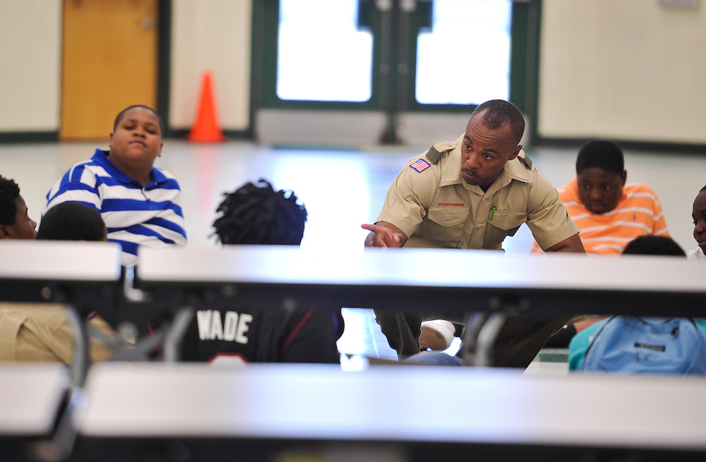 Boy Scout Troop 772 Scoutmaster Rusty Hines talks with the Scouts about their behavior during a meeting at Dan McCarty Middle School on March 19, 2014. (XAVIER MASCAREÑAS/TREASURE COAST NEWSPAPERS)