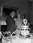 07/02/1953<br /> 02/07/1953<br /> 07 February 1953<br /> Wedding of Ernie Keeffe,  Beechmount, Healy's Bridge, Co. Cork, Irish International Rugby player and Miss Claire O'Shaughnessy, Brighton Road, Rathgar, Dublin. Picture shows the couple at the Standard Hotel, Dublin after the ceremony at Rathfarnham Church.
