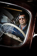 "Napa Valley, April 5 2012 - Roman Coppola posing inside front of the 49 Hudson car used in the movie ""On the Road"" by Walter Salles."