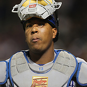 NEW YORK, NEW YORK - June 21: Catcher Salvador Perez #13 of the Kansas City Royals returns to the dugout while catching during the Kansas City Royals Vs New York Mets regular season MLB game at Citi Field on June 21, 2016 in New York City. (Photo by Tim Clayton/Corbis via Getty Images)