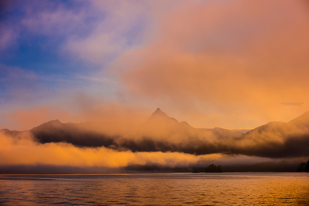 Peaks sticking out of fog banks at sunrise along the Inside Passage, near Sitka, Alaska USA.