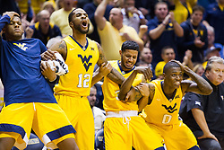 Jan 24, 2017; Morgantown, WV, USA; West Virginia Mountaineers forward Sagaba Konate (50) and West Virginia Mountaineers guard Tarik Phillip (12) and West Virginia Mountaineers guard James Bolden (3) and West Virginia Mountaineers guard Teyvon Myers (0) react on the bench after a made basket during the second half against the Kansas Jayhawks at WVU Coliseum. Mandatory Credit: Ben Queen-USA TODAY Sports