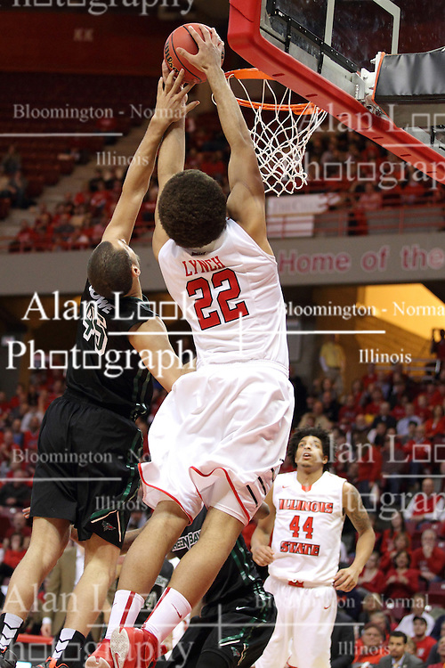 18 March 2015:   Reggie Lynch puts up the ball guarded by Kenneth Lowe during an NIT men's basketball game between the Green Bay Phoenix and the Illinois State Redbirds at Redbird Arena in Normal Illinois