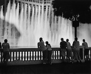 """Water, lots of water, in the middle of a desert from the music-choreographed fountains of the Bellagio Hotel, set in a 32,000 square meter (8 acre) lake, Las Vegas, Nevada, USA.  According to Las Vegas' water czar, Patricia Mulroy, Las Vegas residents' use per person is almost twice the water consumption in New York City and New York receives 10 times the moisture of Las Vegas.  Las Vegas receives 10cm (4 inches) of rain per year.   Mulroy says Las Vegas is a city in """"desert denial""""."""