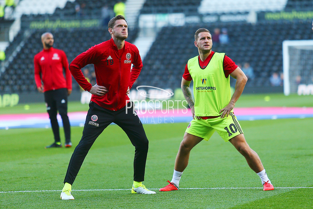 Sheffield United forward Billy Sharp (10) and Sheffield United defender Richard Stearman (19) warm up during the EFL Sky Bet Championship match between Derby County and Sheffield United at the Pride Park, Derby, England on 20 October 2018.