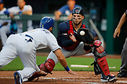 Cleveland Indians catcher Kevin Plawecki (27) catches a throw at home plate as Kansas City Royals' Bubba Starling (11) attempts to score in the second inning of a baseball game at Kauffman Stadium in Kansas City, Mo., Friday, July 26, 2019. Starling was called out on the play.(AP Photo/Colin E. Braley)