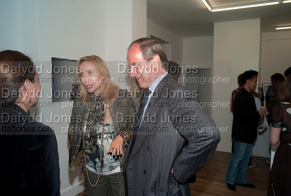 "SIMON DE PURY; MICHAELA DE PURY, Video artist Yi Zhou  first solo show ""I am your Simulacrum"".Exhibition opening at 20 Hoxton Square Projects. Hoxton Sq. London. 1 September 2010.  -DO NOT ARCHIVE-© Copyright Photograph by Dafydd Jones. 248 Clapham Rd. London SW9 0PZ. Tel 0207 820 0771. www.dafjones.com."