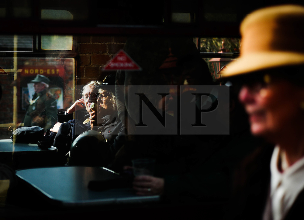 © Licensed to London News Pictures. <br /> 15/10/2016. <br /> Levisham, UK.  <br /> <br /> Enthusiasts dressed in period clothing sit on board a steam locomotive at Levisham station during the North Yorkshire Moors Railway Wartime Weekend event. <br /> The annual event brings together re-enactors and enthusiasts along the length of the NYMR heritage steam railway line to recreate the feel of the war years of the 1940's. <br /> <br /> Photo credit: Ian Forsyth/LNP