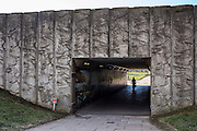 A woman walks through an underpass under the A66 road in central Middlesborough, England, UK.