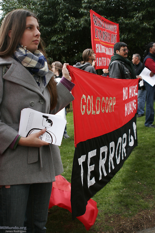 "Independent journalist and activist Dawn Paley (left) and Mario Tema from Sipakapa, Guatemala, hold a banner that reads: ""Goldcorp: No more mining terrorism!"" The activists protested Goldcorp's open pit gold mining operations in Central America during the annual May Day march. Vancouver, BC, Canada. May 1, 2007."
