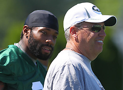 Jun 7, 2012; Florham Park, NJ, USA; New York Jets head coach Rex Ryan and New York Jets cornerback Antonio Cromartie (31) during the New York Jets organized team activities at the Atlantic Health Training Center.