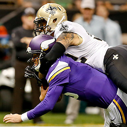 Sep 21, 2014; New Orleans, LA, USA; New Orleans Saints strong safety Kenny Vaccaro (32) tackles Minnesota Vikings quarterback Matt Cassel (16) during the first quarter of a game at Mercedes-Benz Superdome. The Saints defeated the Vikings 20-9. Mandatory Credit: Derick E. Hingle-USA TODAY Sports