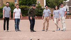 "© Licensed to London News Pictures. 05/06/2015.   London, UK. Media and guests taking part in ""Freddie for the Day"", some dressing up as Queen's lead singer, Freddie Mercury, by playing a special game of celebrity Pétanque, competing for the Londonaise 'Celebrity Pétanque Trophy', ahead of The Londonaise Pétanque festival this weekend in Barnard Park, Islington.  The festival will set a new precedent in the UK with 128 teams taking part in the main tournament.  The event also aims to raise funds for the Mercury Phoenix Trust to fight against AIDS worldwide. Photo credit : Stephen Chung/LNP"