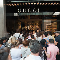 MILAN, ITALY - JULY 03: Shoppers que in front of the Gucci store in the fashion district of Milan on the first day of the Summer Sales on July 3, 2010 in Milan, Italy. Milan's summer sales start today. .***Agreed Fee's Apply To All Image Use***.Marco Secchi /Xianpix. tel +44 (0) 207 1939846. e-mail ms@msecchi.com .www.marcosecchi.com