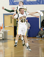 John A. Coleman's Benjamin Mesuda, rear, celebrates with teammate Philip Timbrouck at the end of the third quarter of Coleman's victory over Chapel Field in the Section 9 Class D boys' basketball championship game at Mount Saint Mary College in Newburgh on March 5, 2010.