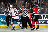 KELOWNA, BC - NOVEMBER 16: Referee Kevin Webinger calls off a goal in front of Nolan Foote #29 of the Kelowna Rockets and Connor Zary #18 of the Kamloops Blazers stands at the officials box and await the result of a goal under review at Prospera Place on November 16, 2019 in Kelowna, Canada. (Photo by Marissa Baecker/Shoot the Breeze)