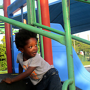 Miami's Little Haiti neighborhood resident Nathaniel Stenor years old, enjoys the jungle gym at Range Park. Stenor, who was at that park with his mother, goes to the Park on the weekends.  (Photo by Norzilia Mezinord).