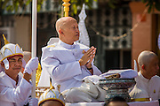 "01 FEBRUARY 2013 - PHNOM PENH, CAMBODIA:  A son of former Cambodian King Norodom Sihanouk during the funeral procession for his father in Phnom Penh. Norodom Sihanouk (31 October 1922 - 15 October 2012) was the King of Cambodia from 1941 to 1955 and again from 1993 to 2004. He was the effective ruler of Cambodia from 1953 to 1970. After his second abdication in 2004, he was given the honorific of ""The King-Father of Cambodia."" Sihanouk died in Beijing, China, where he was receiving medical care, on Oct. 15, 2012. His cremation is will be on Feb. 4, 2013. Over a million people are expected to attend the service.   PHOTO BY JACK KURTZ"