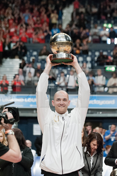 © Licensed to London News Pictures. 28/04/2013. London, UK. Barry Lamble, captain of The Leicester Riders raises the British Basketball League cup after his team beat the Newcastle Eagles in the playoff final of the British Basketball League 2013.  The Newcastle Eagles are defending their title having won it in 2012.  The British Basketball League (BBL), is the premier men's professional basketball league in the United Kingdom. The BBL runs two knockout competitions alongside the league Championship; the BBL Cup and the BBL Trophy, as well as the post-season Play-offs.  Photo credit : Richard Isaac/LNP