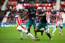 Mame Biram Diouf of Stoke City challenges Mario Lemina of Southampton - Mandatory by-line: Matt McNulty/JMP - 30/09/2017 - FOOTBALL - Bet365 Stadium - Stoke-on-Trent, England - Stoke City v Southampton - Premier League