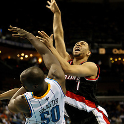 March 30, 2011; New Orleans, LA, USA; Portland Trail Blazers shooting guard Brandon Roy (7) shoots over New Orleans Hornets center Emeka Okafor (50) during the fourth quarter at the New Orleans Arena. The Hornets defeated the Trail Blazers 95-91.   Mandatory Credit: Derick E. Hingle