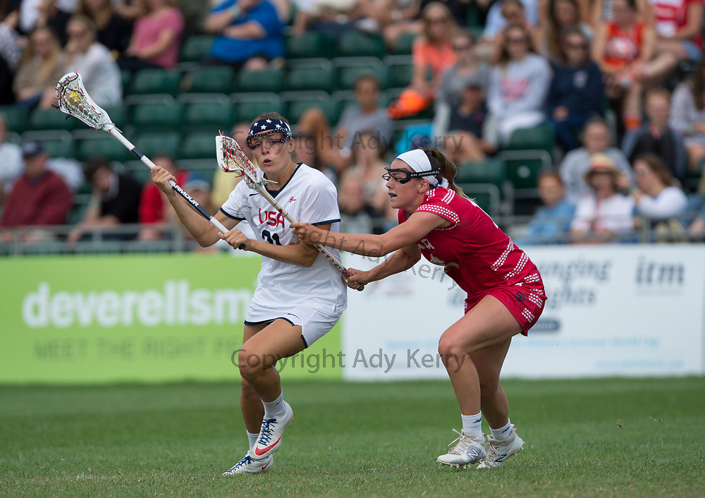 Canada's Erica Evans  challenges with USA's Taylor Cummings at the Rathbones Women's Lacrosse World Cup, at Surrey Sports Park, Guildford, Surrey, UK, 16th July 2017.