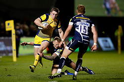 Josh Adams of Worcester Warriors is tackled by Byron McGuigan of Sale Sharks - Mandatory by-line: Matt McNulty/JMP - 07/04/2017 - RUGBY - AJ Bell Stadium - Sale, England - Sale Sharks v Worcester Warriors - Aviva Premiership