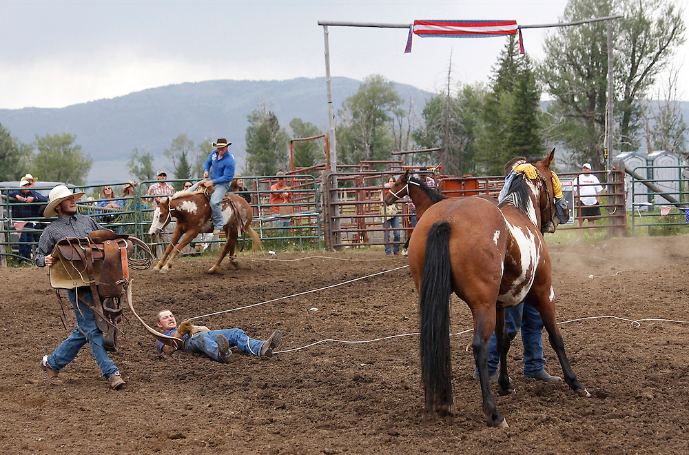 Catching and riding a wild horse team event at the Island Park Rodeo, Island Park, Idaho, USA, August 02, 2009.  Credit:SNPA / Pam Johnson