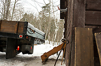 A signal from inside the Rockywold Ice House stops the incoming truck as they begin to unload ice blocks during the annual RDC ice harvest on Tuesday.  ©2018 Karen Bobotas Photographer