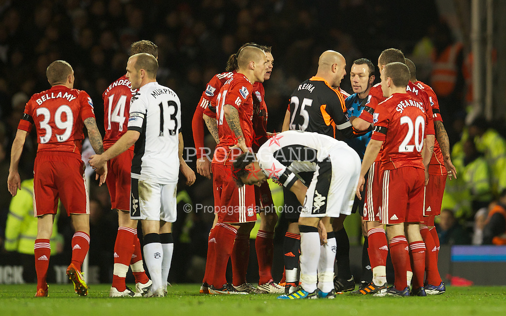 LONDON, ENGLAND - Monday, December 5, 2011: Liverpool's captain Jose Reina players and team-mates surround the referee Kevin Friend after he sent off Jay Spearing during the Premiership match against Fulham at Craven Cottage. (Pic by David Rawcliffe/Propaganda)