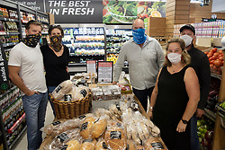 "South Africa - Plettenberg Bay - 8 May 2020 - Pictured left to right is Morné Rheeder and Mariska Rheeder of Zanzos, Duncan Brown of Kwikspar, and Emmy-Lou Mills and Brent Mills, of ROOST cafe. The Kwikspar in Plettenberg Bay, Beacon Isle KWIKSPAR, owned by Duncan Brown, has set up a special table to promote and sell products from local businesses that are unable to trade under the lockdown regulations. A sign on the table reads ""Support our Local Businesses. All items on this table are supplied by local restaurants. They are still unable to welcome you into their businesses. Kwikspar will not add any markup to these products, and all sales will go directly to them."" South Africa is currently under lockdown in an attempt to flatten the curve to halt the spread of the COVID-19 coronavirus pandemic. Picture: David Ritchie/African News Agency(ANA)"