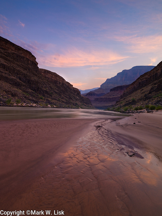 Magenta clouds fill the sky upstream of Stone Creek, in the Grand Canyon.