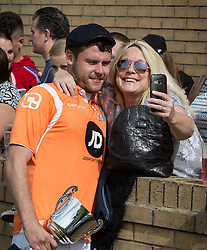© Licensed to London News Pictures . 02/08/2015 . Droylsden Football Club , Manchester , UK . DANNY MILLER posing with fans . Celebrity football match in aid of Once Upon a Smile and Debra , featuring teams of soap stars . Photo credit : Joel Goodman/LNP