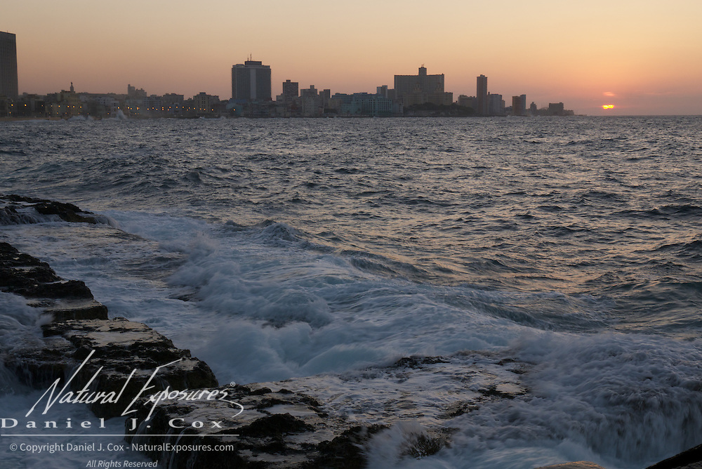 Sunset from the Malecon, over the waters on the North side of Havana, Cuba.