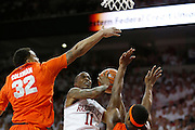 FAYETTEVILLE, AR - NOVEMBER 30:  BJ Young #11 of the Arkansas Razorbacks drives to the basket past DaJuan Coleman #32 of the Syracuse Orangemen at Bud Walton Arena on November 30, 2012 in Fayetteville, Arkansas.  The Orangemen defeated the Razorbacks 91-82.  (Photo by Wesley Hitt/Getty Images) *** Local Caption *** BJ Young; DaJuan Coleman