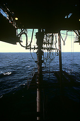 Stock photo of a blowout preventer stack under an offshore semi-submersible drilling rig