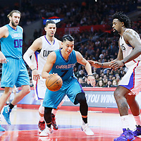 09 January 2016: Charlotte Hornets guard Jeremy Lin (7) drives past Los Angeles Clippers guard Austin Rivers (25) and Los Angeles Clippers center DeAndre Jordan (6) during the Los Angeles Clippers 97-83 victory over the Charlotte Hornets, at the Staples Center, Los Angeles, California, USA.