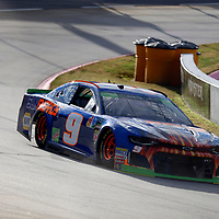 Chase Elliott (9) races through turn three to practice  for the First Data 500 at Martinsville Speedway in Martinsville, Virginia.