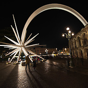 VERONA, ITALY - DECEMBER 04: The white steel shooting star whose comet tail is seen coming out from the Arena has now become the symbol of Christmas in Verona on November 4, 2010 in Verona, Italy. Christmas markets, fairs, lights and nativity scenes fill Northern Italian cities and villages from December through January 6.