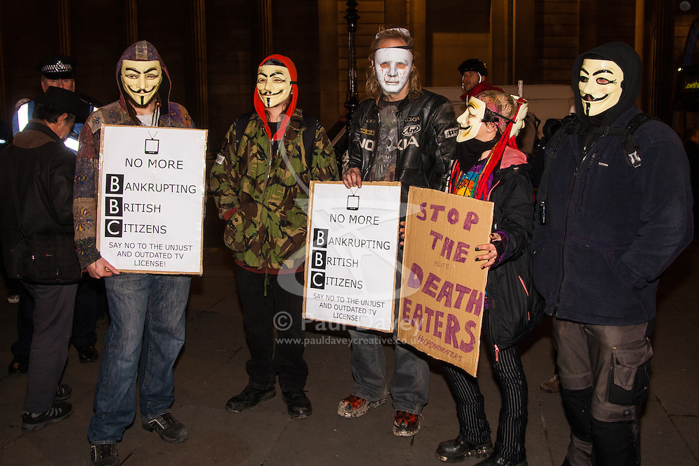 "London, December 23rd 2014. Online activism group Anonymous march through London from the City to the BBC's HQ on Great Portland Street in protest against alleged biases and coverups of a ""paedophile ring"". PICTURED: Protesters await the beginning of their march outside the Royal Exchange"