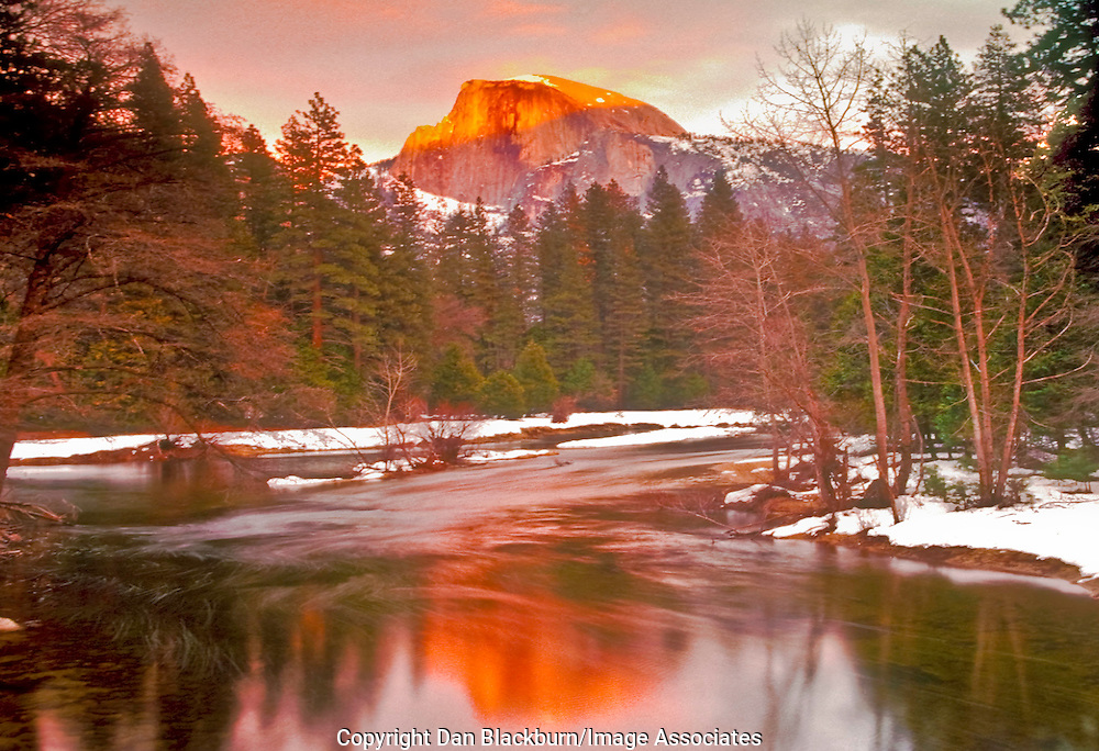 Sunset Lights Up Famed Half Dome and the Merced River in Winter in Yosemite National Park California