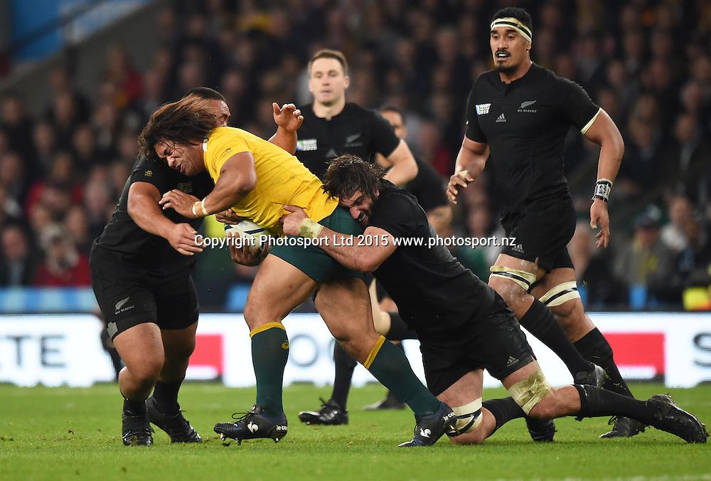 Tatafu Polota-Nau is tackled by Sam Whitelock during the Rugby World Cup Final. New Zealand All Blacks v Australia Wallabies, Twickenham Stadium, London, England. Saturday 31 October 2015. Copyright Photo: Andrew Cornaga / www.Photosport.nz